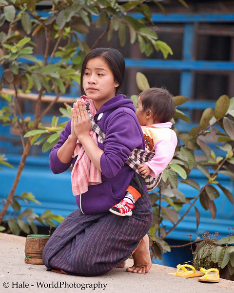 """Ban Khone Villager And Baby Making Merit, """"Tum Boon"""", By Giving Food to Monks, Ban Khone  Luang Nam Tha Province, Laos"""