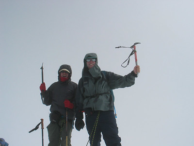 On the summit behaving like climbers when they have reached the top of something.