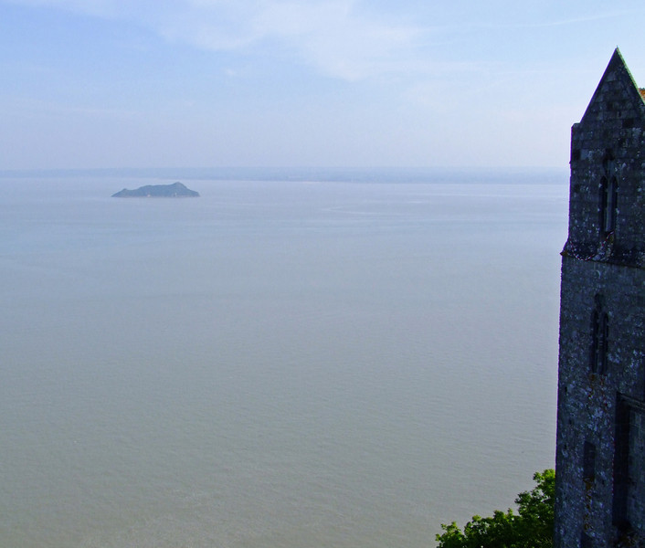 Isle of Tombelaine less than 2 miles north of Mont Saint Michel.  Note in this high tide view the abbey is surrounded by water.