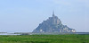 Mont Saint Michel is an ancient Abbey that was built upon a rock at the edge of a bay.  During high tide it is completely surrounded by water but during low tide by only sand.