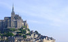 Mont Saint Michel is a tourist attractions for millions each year.  The lower area is a village with gift shops, restaurants, hotel, etc.