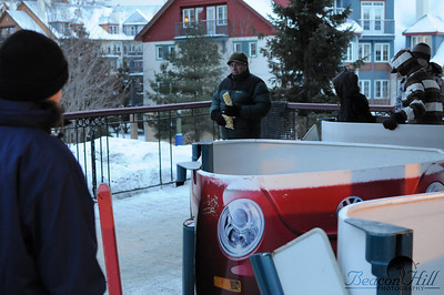 The cabriolet lift, takes folks up from the parking lot to the base area where the ski lifts start. Sarah here is lusting after the red beetle gondola chair.