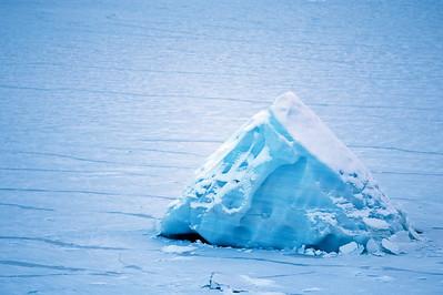 Iceberg In Frozen Lake