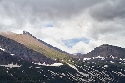 High mountains in Glacier National Park covered in snow.