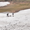 Kids playing on the snowfield near Beartooth Summit in Late June.