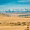 Crazy Mountains from Shane Creek Road.  Mountains are 65 miles to the northwest.<br /> Nikon F3, 180mm f/2.8 Fujicolor 400.  December 1999.