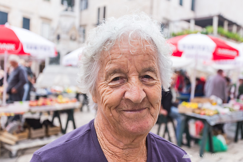 A friendly vendor at the farmer's market in Dubrovnik