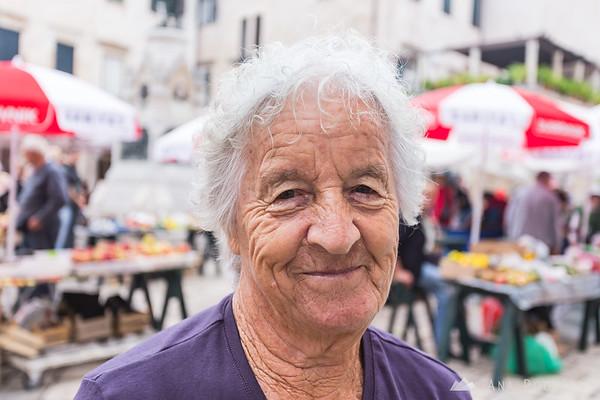 A friendly vendor at the farmer's market in Dubrovnik