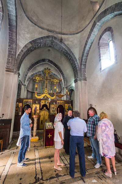 A baby was being baptized in a small church in Kotor