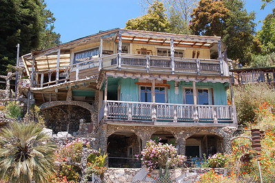 "This picture is of a house in San Simeon that was built completely from other people's garbage. The man who built it has ""gone away"", and a married couple now own it. They give private tours upon reservation only! Sign me up!!!"
