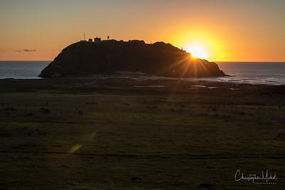 The sun setting over Point Sur Lighthouse.