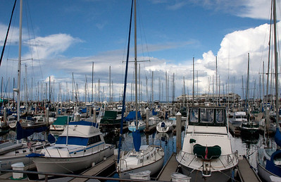 Boats moored by Fisherman's wharf, with more beautiful sky and clouds.