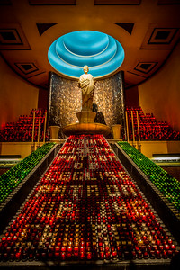 The central lampstand in front of the statue of Saint Joseph holds some 3500 votive candles. The chapel as a whole contains 10,000 candles.