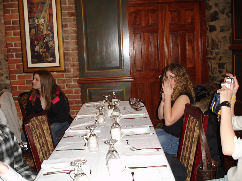Rachel covering her nose for some reason at our table