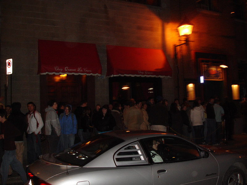 people lining up to go into a club