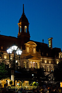 Vauquelin Place in Old Montreal at night.