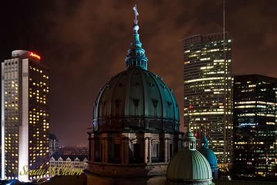 Marie Reine du Monde Basilica at night.