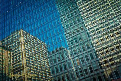 Buildings reflect in the glass of Royal Bank's Corporate Archives building.