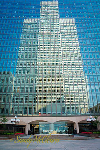 1 Place Ville Marie reflects in the glass of Royal Bank's Corporate Archives building.