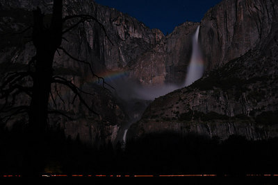 Moonbow on saturday night - in the middle of the Upper Yosemite falls. Here you can see the two ends of the moonbow along with streaks of car lights at the bottom