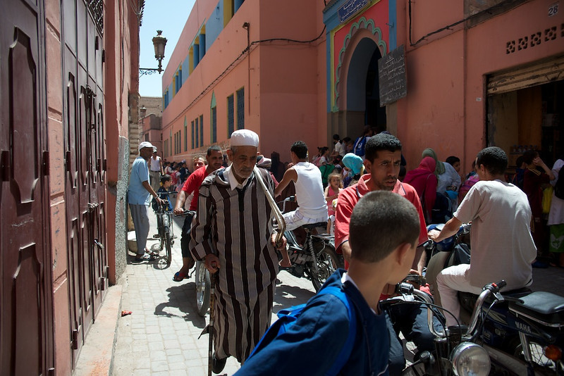 Marrakesh street scene. I love the facial expression on the guy at center right.