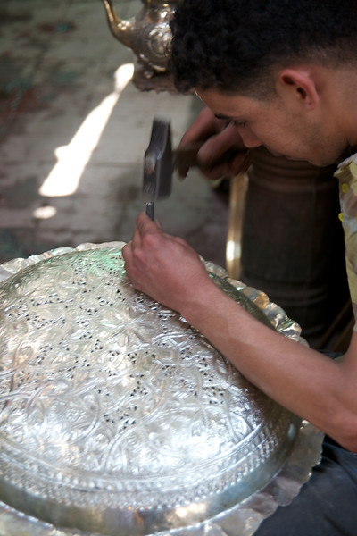Artisan making a lamp in the souks of Marrakesh.