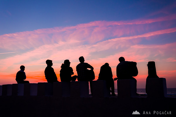 Musicians playing after sunset on the wall of the fort in the medina of Asilah, a town on the Atlantic coast