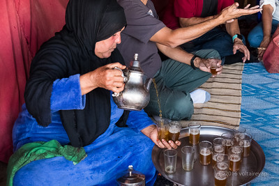 The Moroccan way of pouring mint tea.