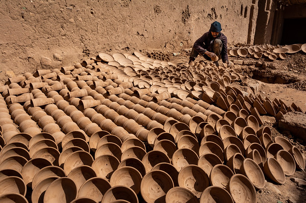Terracotta bowls and pots being put out to dry, Morocco