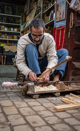 Woodworker making chees pieces - Market stall - Marrakech, Morocco