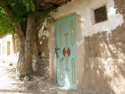 Metal door done in style of older wooden doors.