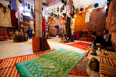 After lunch Mamadu showed us his anitque shop. Bringing out all the carpets and explained the meaning behind the patterns.