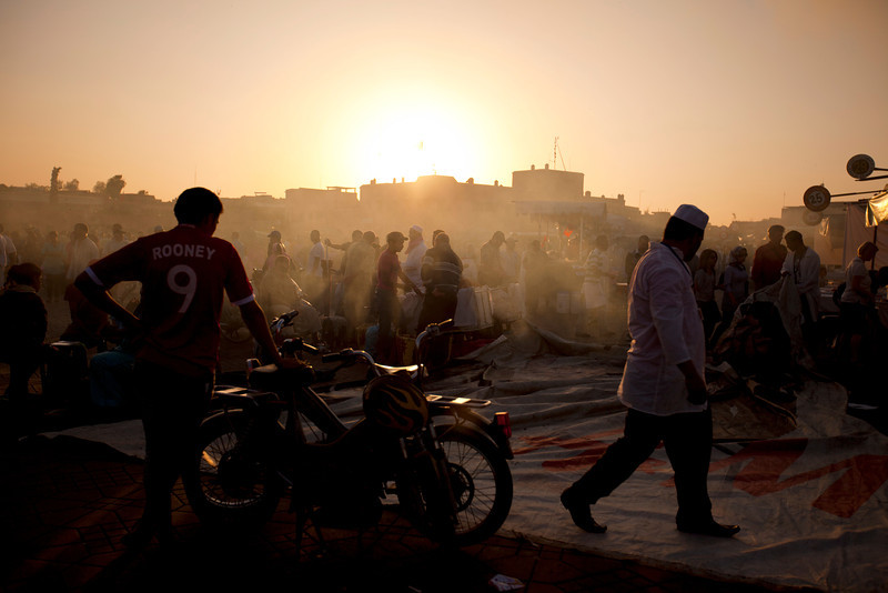As night falls, food vendors rush to set up food stalls for another night of nonstop cooking and competition.  Once the tables are set and the stoves are ready, a fierce competition to pull in customers starts and Jemaa el Fna square turns into one big smokey open-air restaurant.
