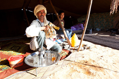 A friendly nomad family invited us for tea. There were a few photographers there documenting the Berber woman making carpet.