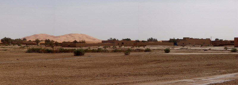 wide open space comes to an abrupt end at the sand dunes