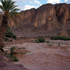 Fint River near Ouarzazate covering the road to a small oasis village