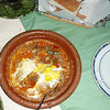 Main course of tagine with lamb, olives, apricots, eggs
