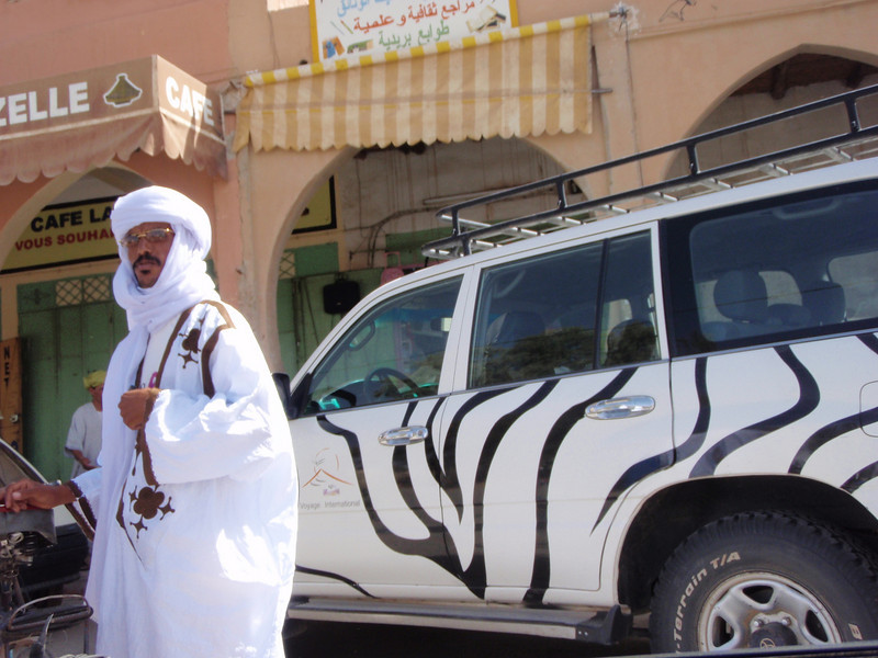 Merzuga Tuareg tour guide with his mechanical camel