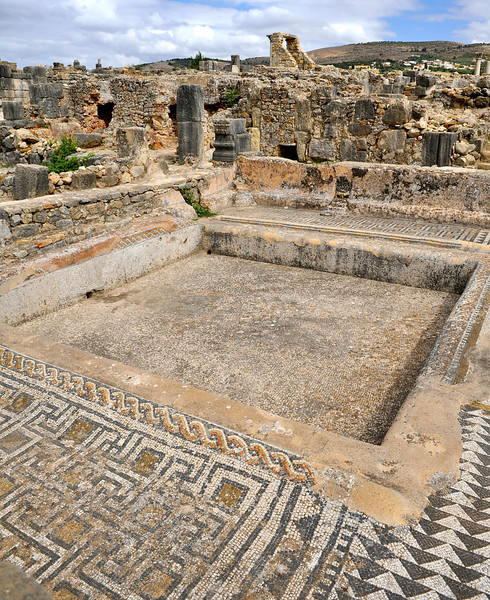 Courtyard pool surrounded with mosaic