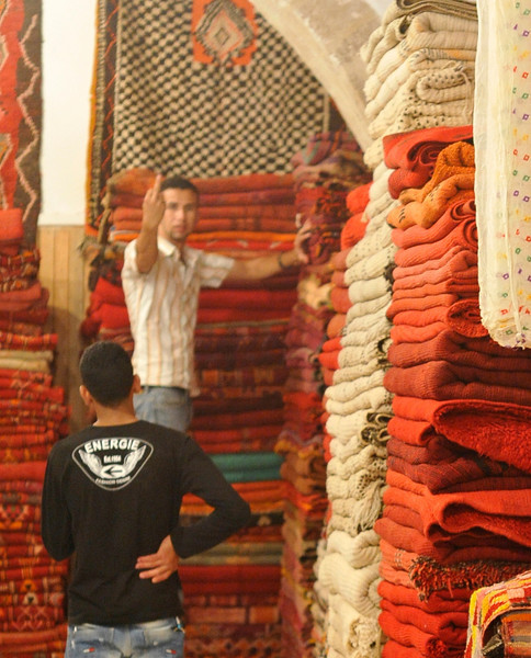 Carpet vendor taking exception to his photo being taken. Many Muslims are extremely camera shy, as the Koran prohibits images of people or animals
