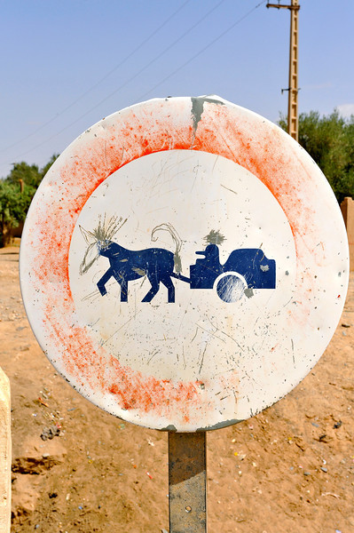 """No donkey carts on this road"" Some artistic adjustment is noted"