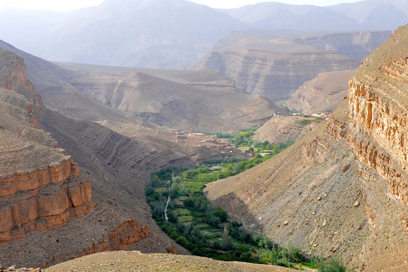 Upper Dades Gorge. Heavy layers of sedimentary mountains much like the Grand Canyon in USA. The thin green strip of gardens follows the length of this canyon.