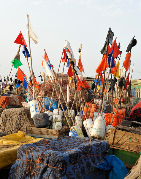 Each fisherman has his own set of flags on his net floats