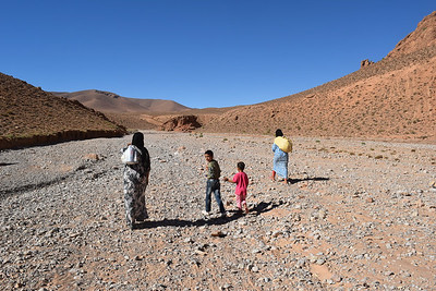 The nomadic family departed for the long walk back home up the river canyon