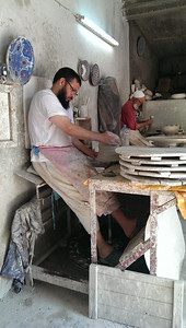 Master artisans at the pottery works in Fez, Morocco.