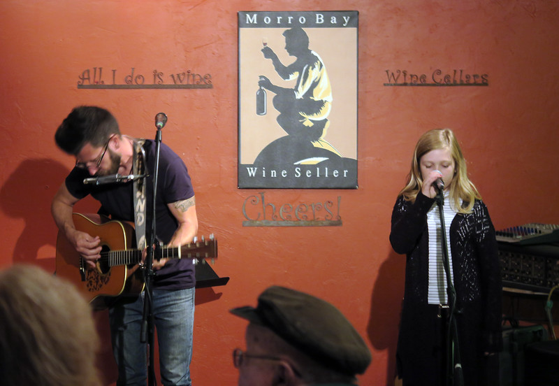 13-year-old Harmony and her dad Chris at the Wine Seller (Beland).