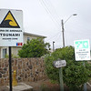 Tsunami hazard zone and evacuation route signs at the beach in Pichidangui.
