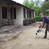 Jill playing with a dog at the Viu Manent winery in the Colchagua valley.
