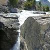a glimpse of a waterfall south of Cochrane