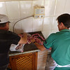Roberto and his dad preparing the meat with salt, and salt alone